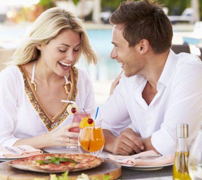 19530450 - couple enjoying meal in outdoor restaurant